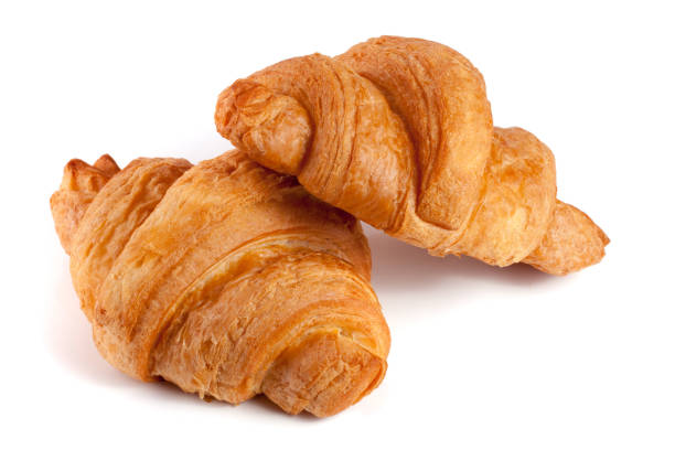 two croissant isolated on white background closeup - foto stock