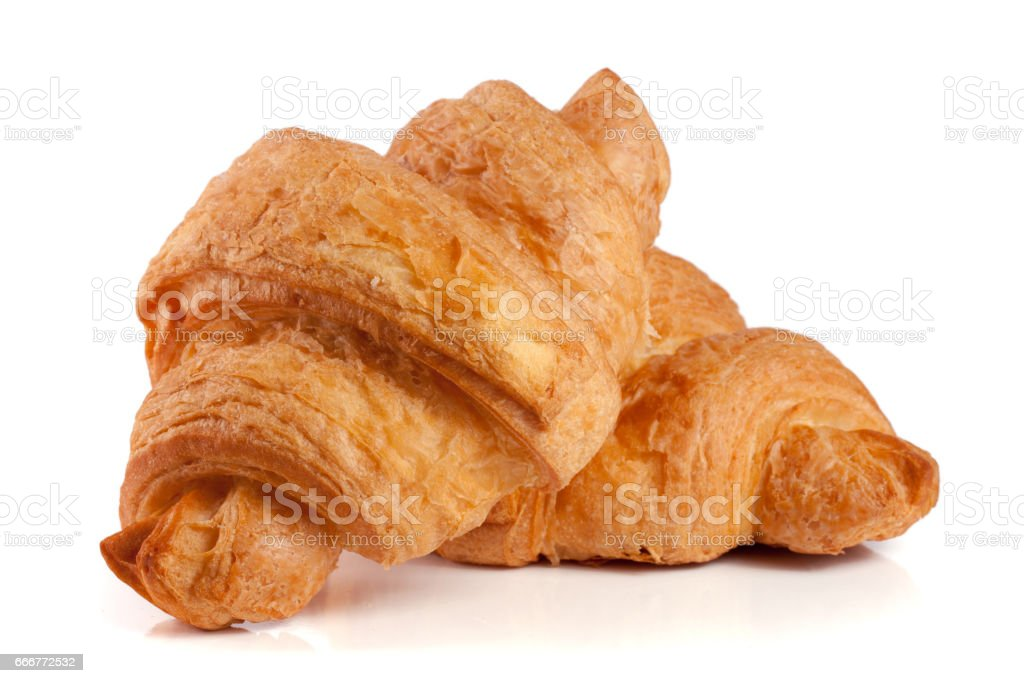 two croissant isolated over a white background closeup foto stock royalty-free