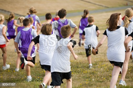 986840244istockphoto Two Cross Country Teams in a Big Race 92041157