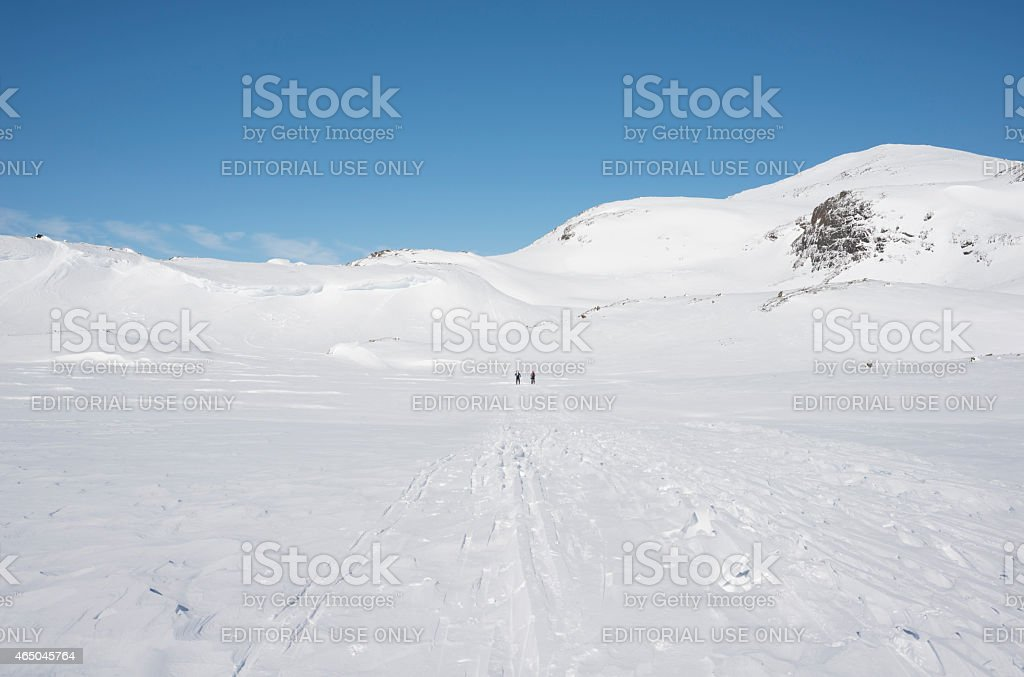 Two cross-country skiers on a mountain plateau stock photo