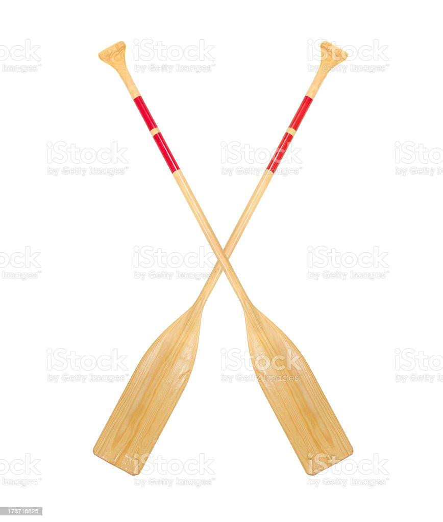 Two crossed wooden paddles on a white background stock photo