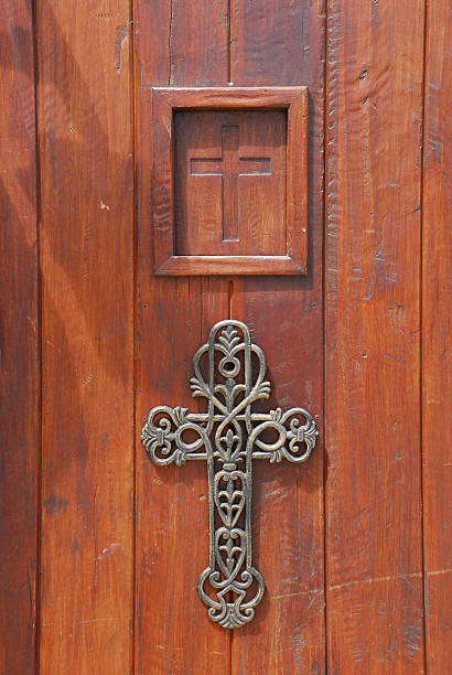two crosses on a church door stock photo