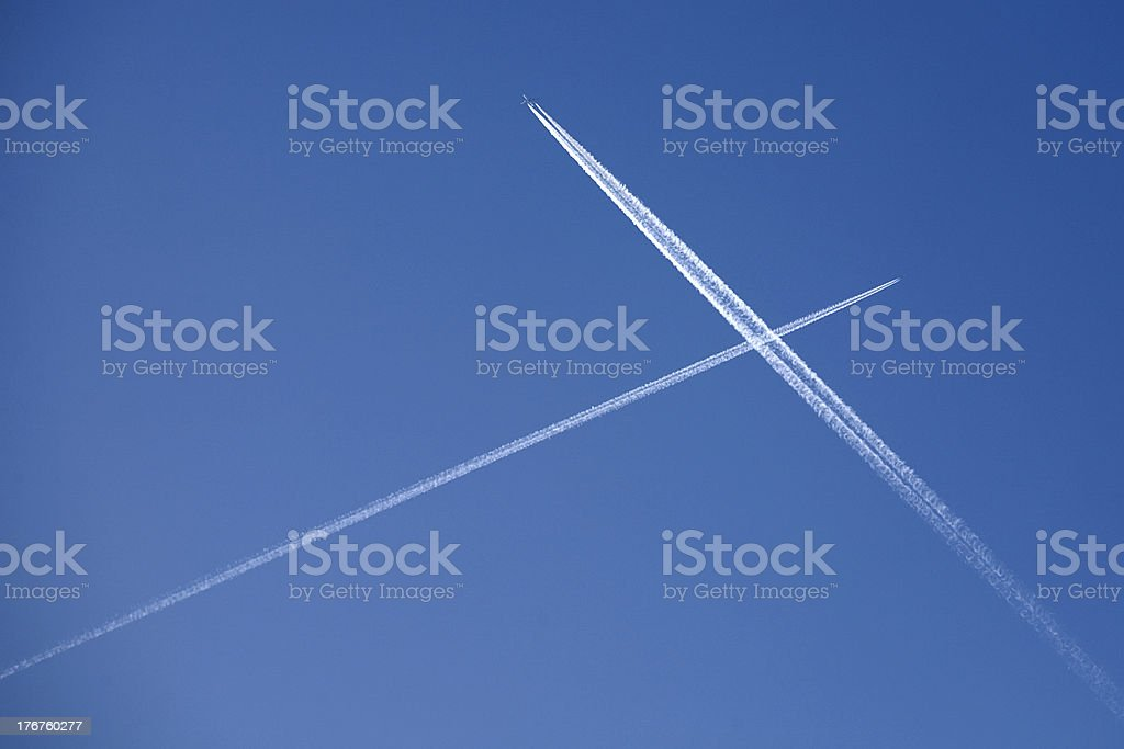 Two crossing plane traces stock photo