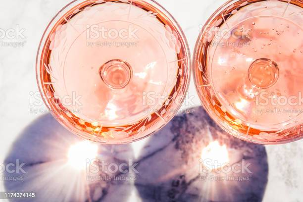 Two crystal stemmed glasses with rose wine picture id1174374145?b=1&k=6&m=1174374145&s=612x612&h=e4drqaoumrjumdyhc82b fcmgoksg37jf1dyf03glb4=