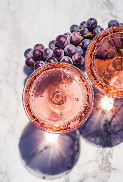 Two crystal stemmed glasses with rose wine stock photo