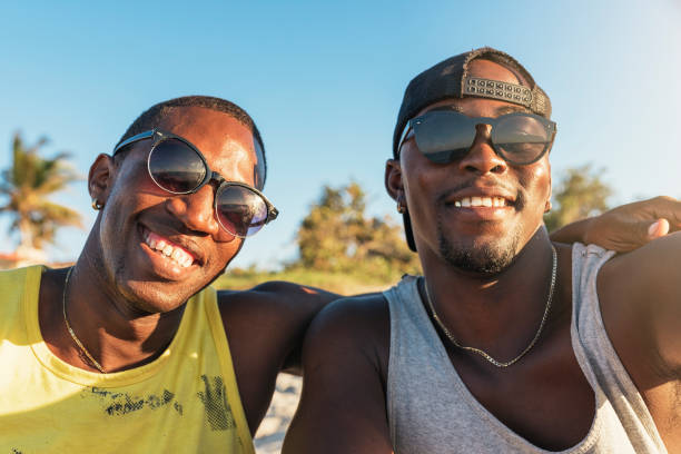 Two cuban friends taking selfie with his mobile. stock photo