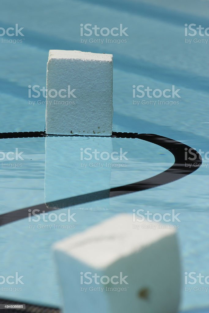 Two cubes of expanded polystyrene floating in a swimming pool royalty-free stock photo