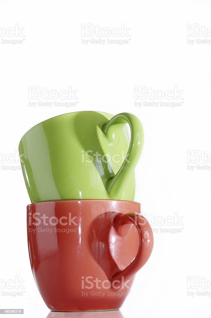 Two cups and hearts royalty-free stock photo