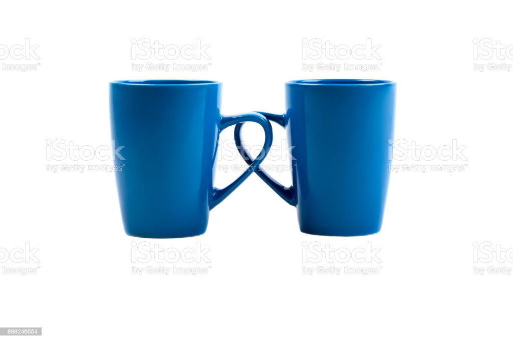 two cups in front of a white background stock photo