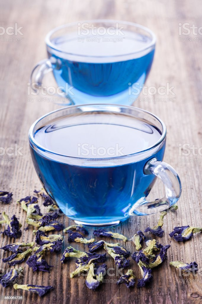 Two cups of Butterfly pea tea (pea flowers, blue pea) for healthy drinking stock photo