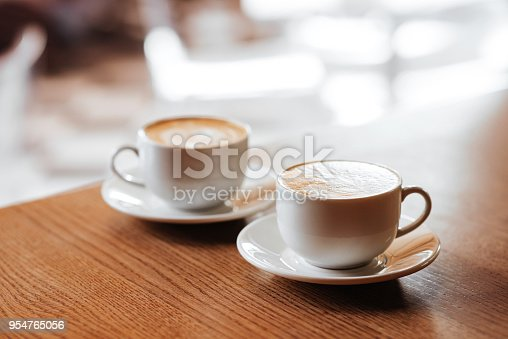 istock Two cups of cappuccino with latte art 954765056