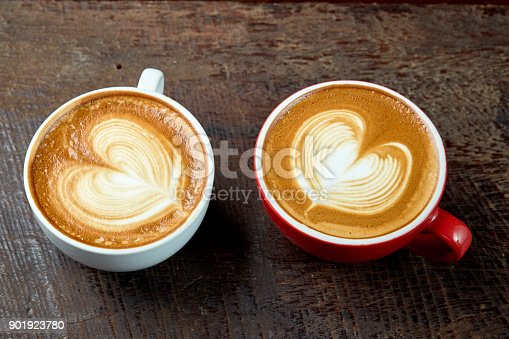istock two cups of coffee cappuccino with heart shape 901923780