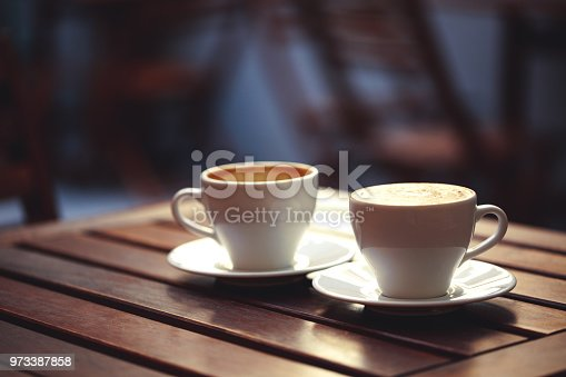 istock Two cups of coffee in cafe. 973387858