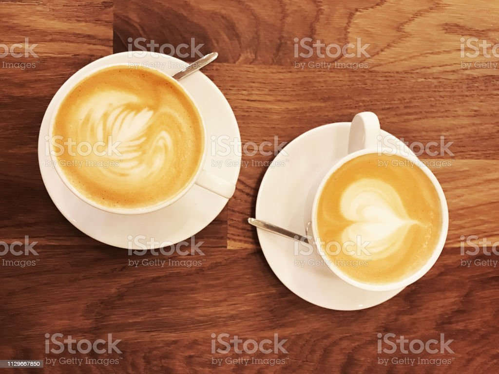 Two Cups Of Coffee On Wooden Table Good Morning Together In