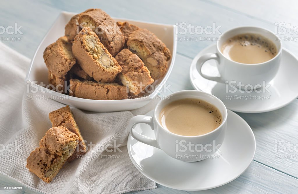 Two cups of coffee with cantuccini stock photo