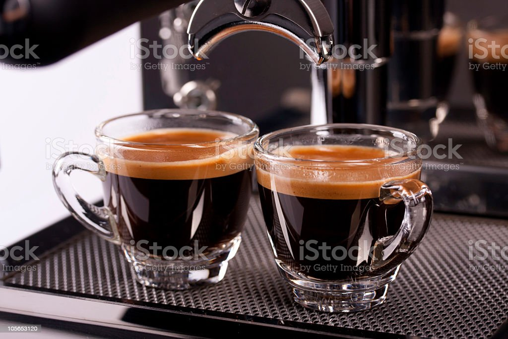 two cups of espresso shot with crema stock photo