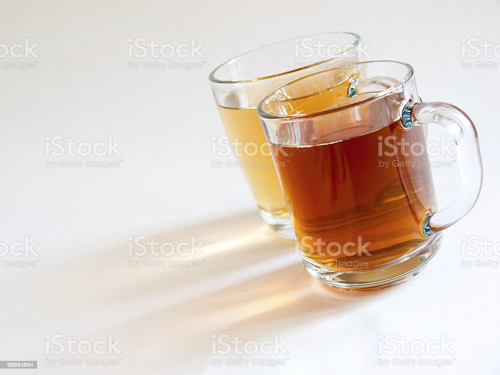 Two cups of green and black tea royalty-free stock photo
