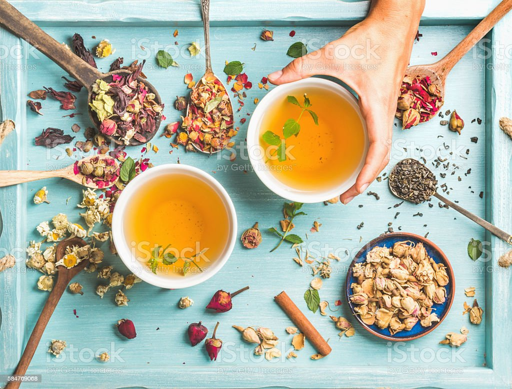Two cups of healthy herbal tea with mint, cinnamon, dried stock photo