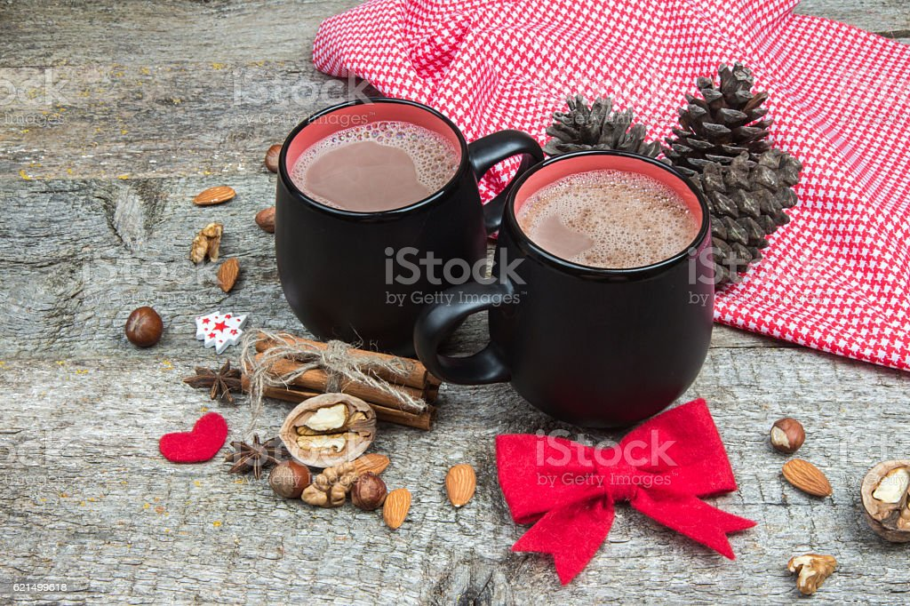 Two cups of hot chocolate and Christmas decorations. Wooden background Lizenzfreies stock-foto