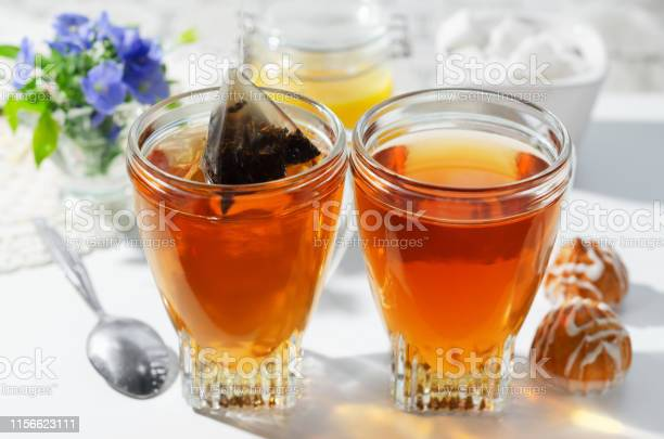 Two cups of hot tea bags cookies and honey the process of brewing tea picture id1156623111?b=1&k=6&m=1156623111&s=612x612&h=ebirhvchyoih7fk4crhi5pzeqjnvv g2qxp ln8nmdy=
