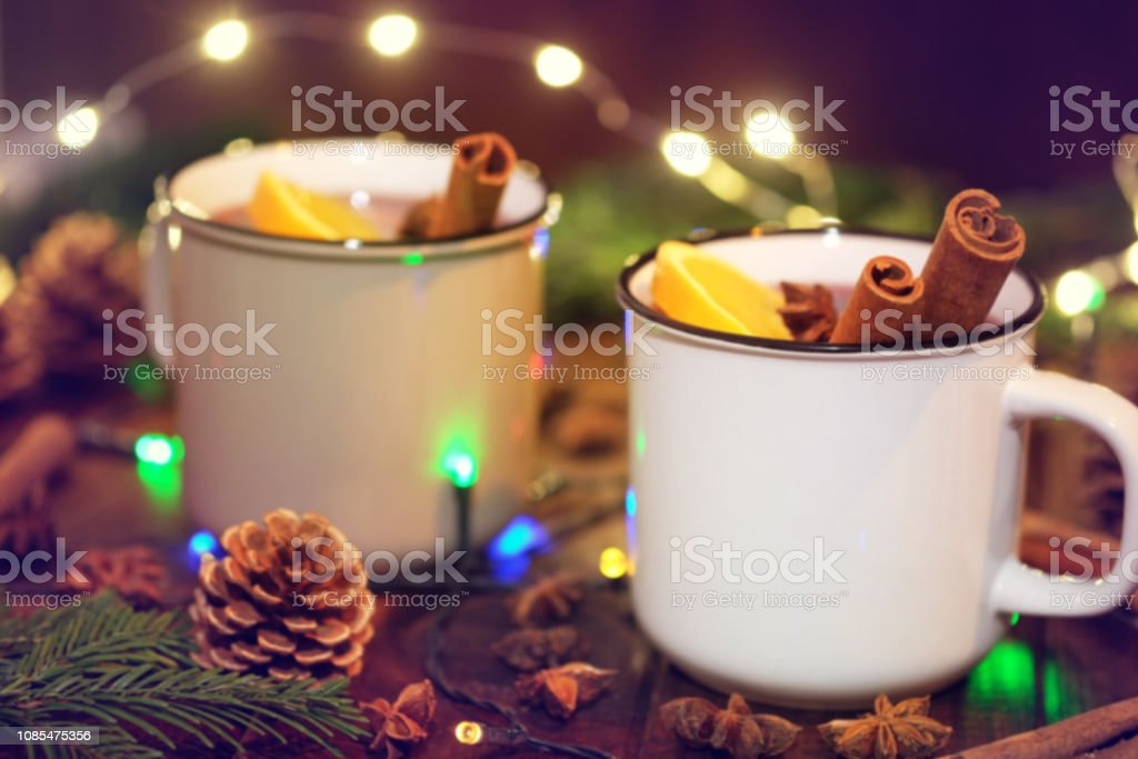 Two cups of mulled wine with Christmas decoration. stock photo