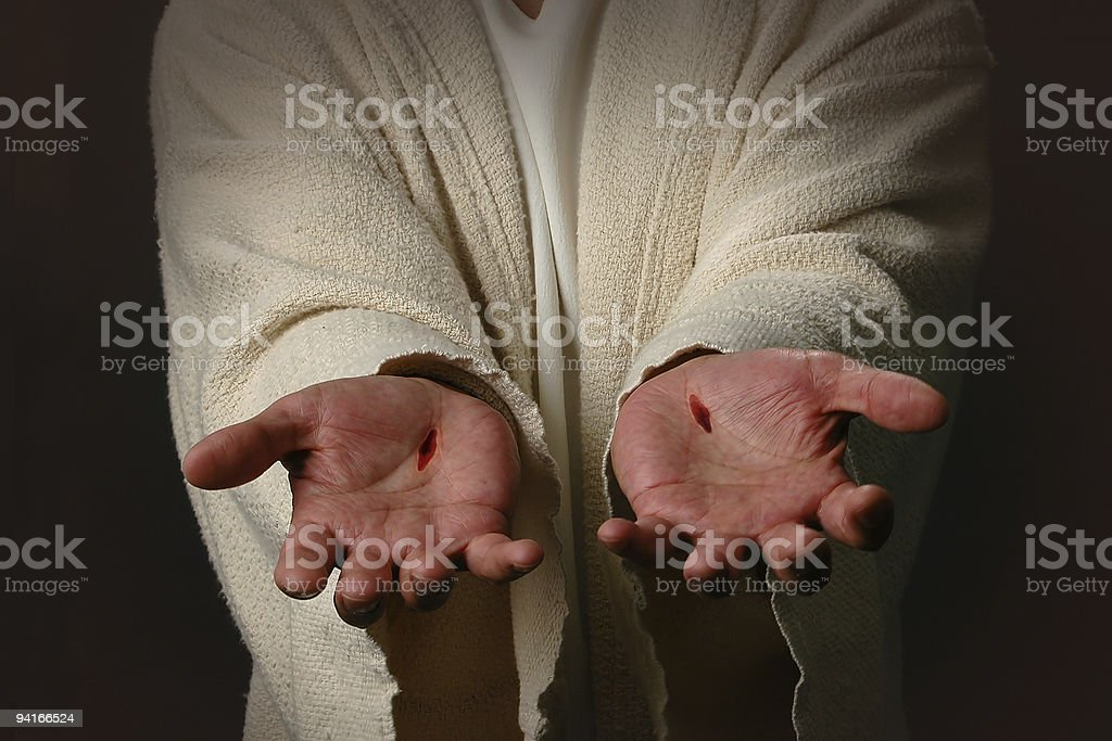 Two cut hands representing Jesus stock photo