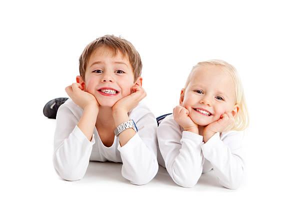 Two cute children grin