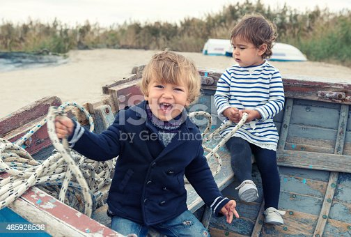 istock Two cute children playing in the boat 465926536