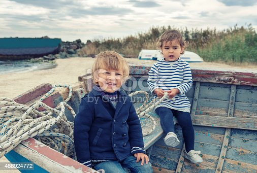 istock Two cute children playing in the boat 466924772
