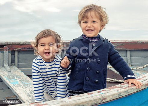 istock Two cute children playing in the boat 468836310