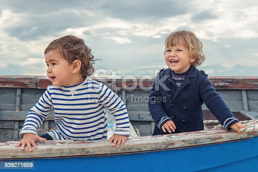 istock Two cute children playing in the boat 539271659