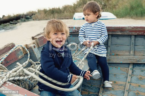 istock Two cute children playing in the boat 539271873