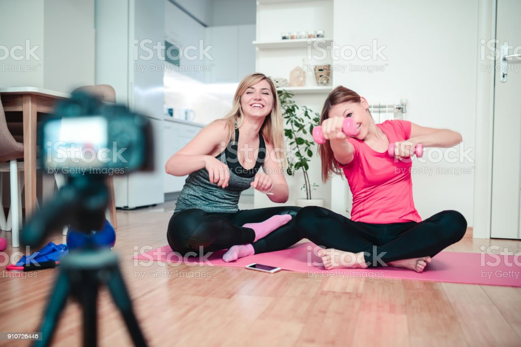 Two Cute Females Making Vlog about Pilates and Healthy Lifestyle stock photo