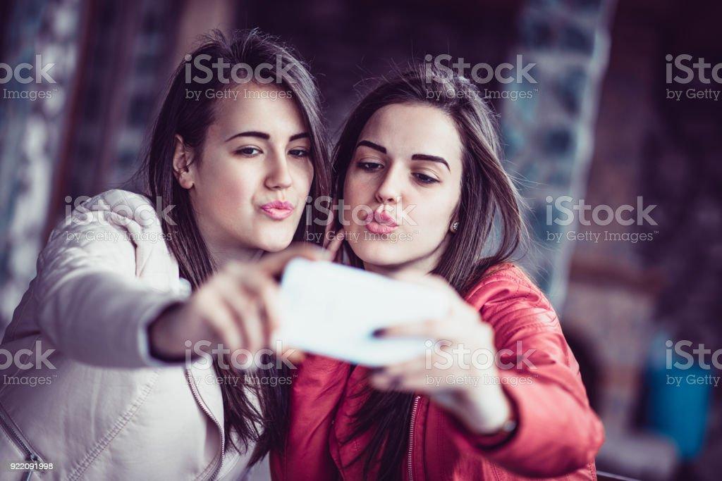 Two cute girls kissing