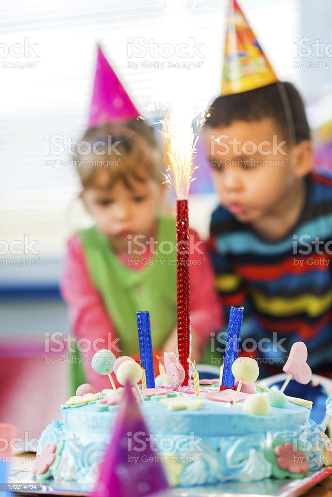 Two cute kids celebrating birthday. royalty-free stock photo