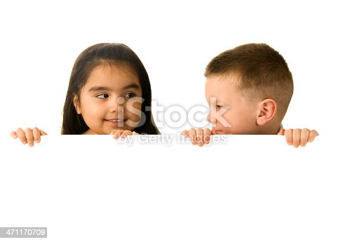 519837800 istock photo Two cute kids holding blank sign 471170709