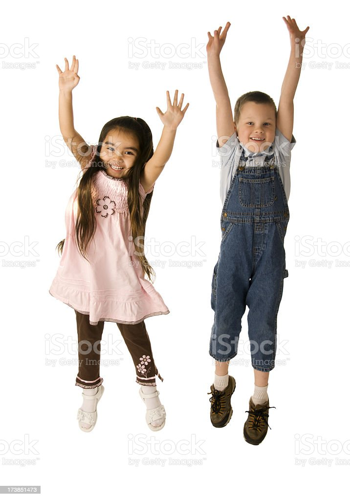 Two cute kids jumping stock photo