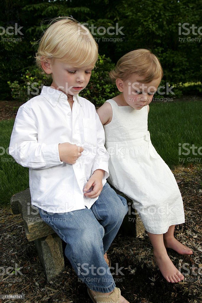 two cute kids outside on bench royalty-free stock photo