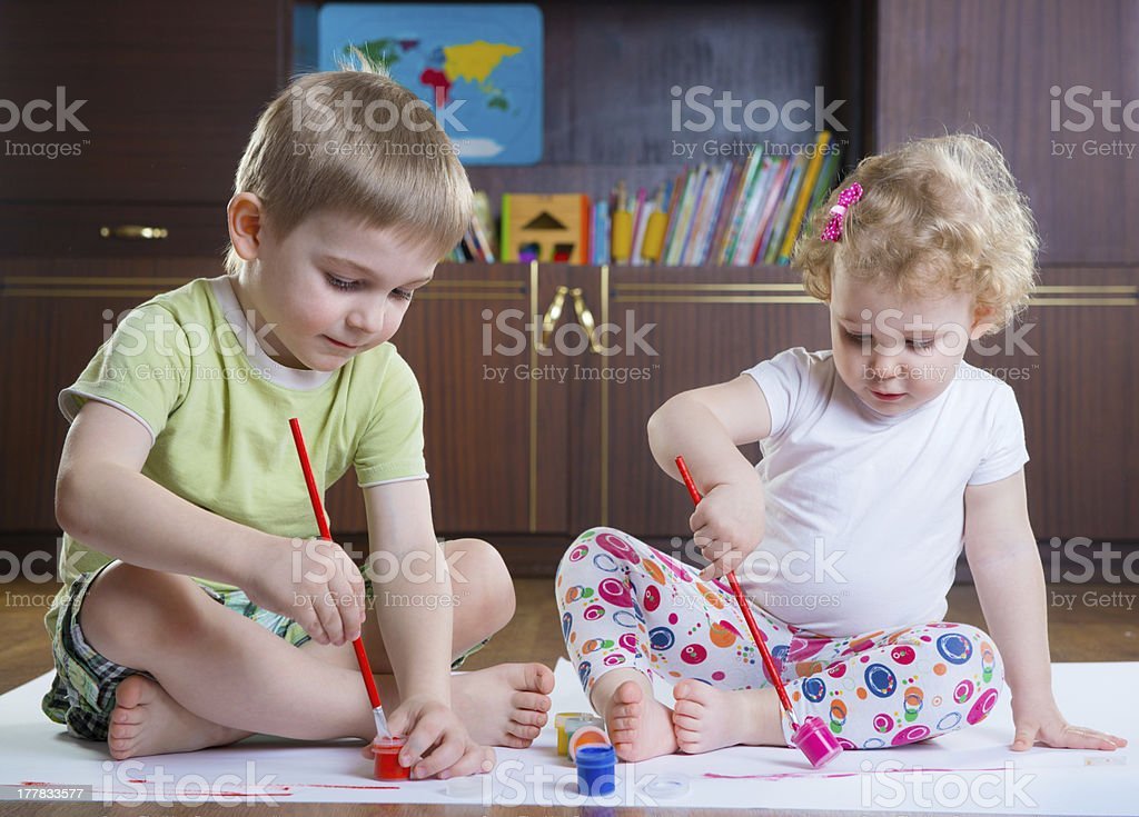 Two cute kids painting royalty-free stock photo