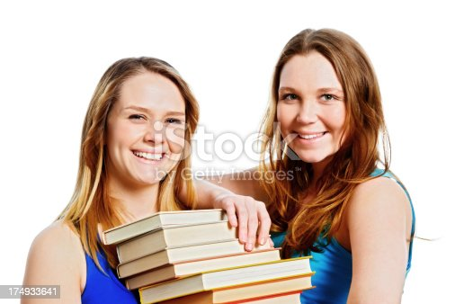 639569206 istock photo Two cute, laughing women with a stack of books 174933641