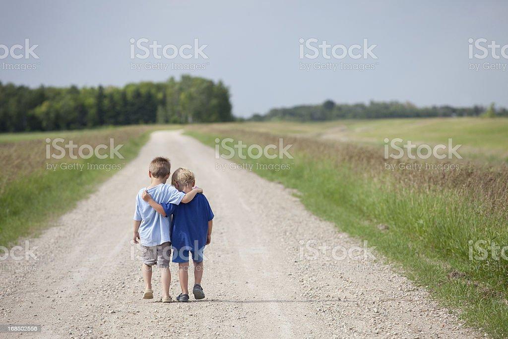 Two Cute Preschool Boys Walking Down the Road stock photo