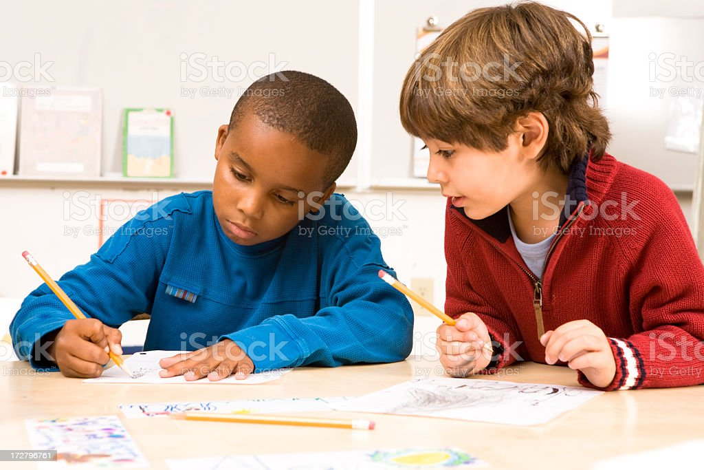 Two cute school boys doing homework together royalty-free stock photo