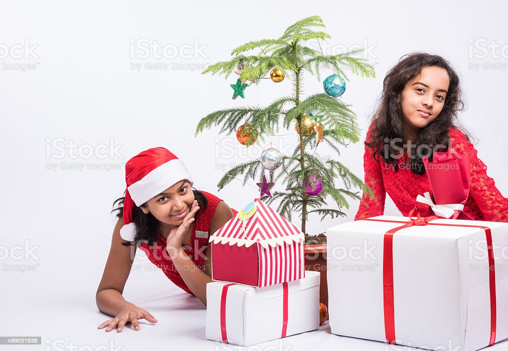 Two Cute Small Indian Girls With Christmas Gifts Stock Photo