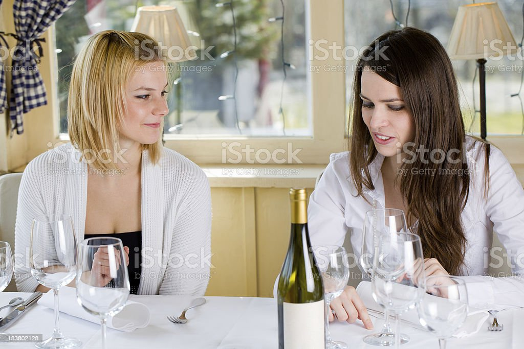 Two cute young girls waiting for lunch in fancy restorant stock photo