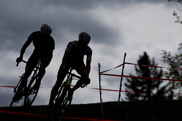 two cyclo-cross racers - cyclocross stock-fotos und bilder