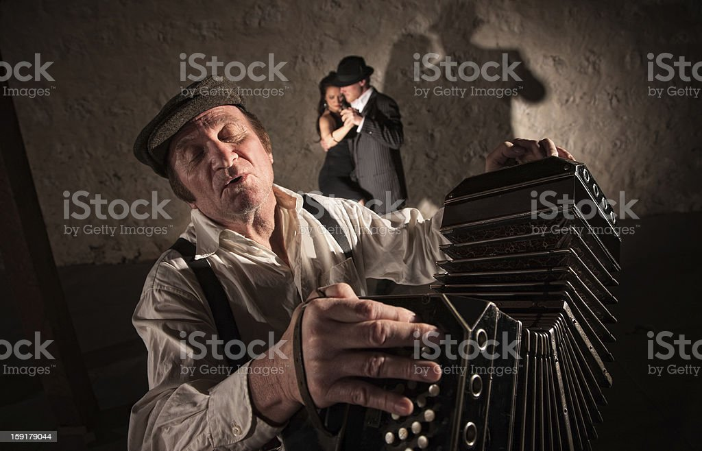 Two Dancers Near Bandoneon Player royalty-free stock photo