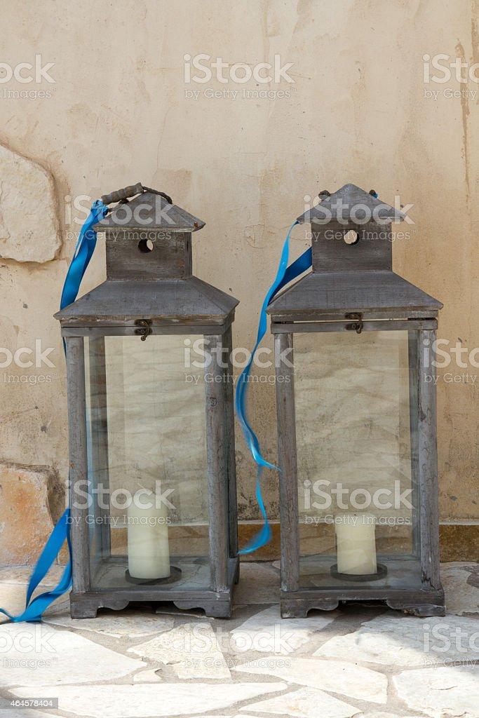 two dark grey candle laterns stock photo