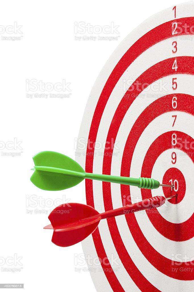 two dart hitting a target stock photo