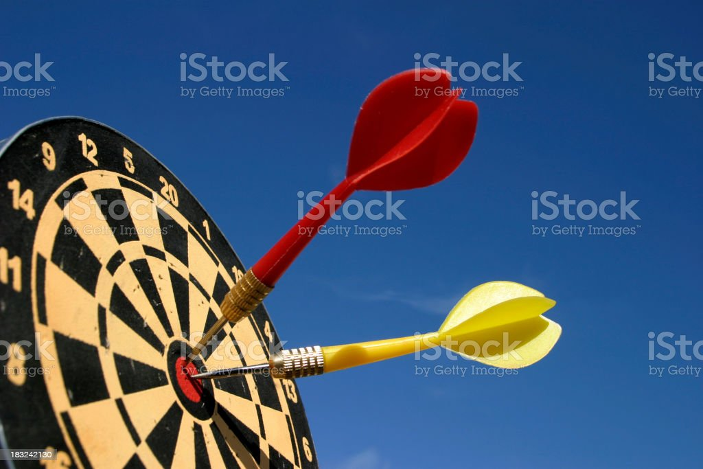 Two darts in the center of the bulls eye royalty-free stock photo