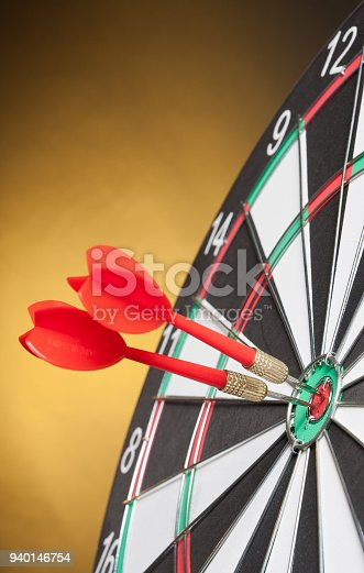 istock Two Darts in the center of the target dartboard 940146754
